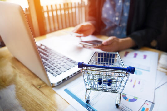 cropped-image-of-woman-inputting-card-information-and-key-on-phone-or-laptop-while-shopping-online